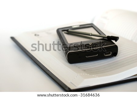 PDA and agenda - stock photo
