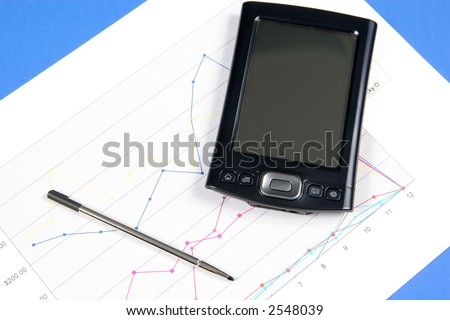 PDA and Chart on blue background - stock photo