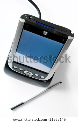 PDA in cradle with stylus on white background