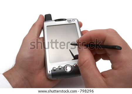 PDA in man's hands - stock photo