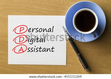 PDA Personal Digital Assistant - handwriting on paper with cup of coffee and pen, acronym business concept