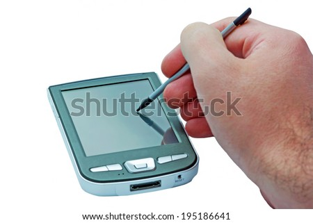 PDA phone with touch screen and stylus in hand. - stock photo