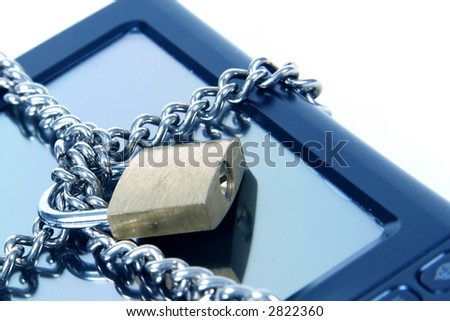 PDA with Lock and chain over it.  Taken Closeup - stock photo