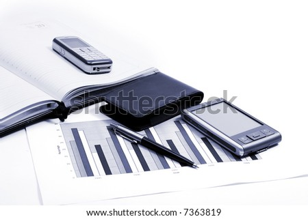 PDA with stylus and pen - stock photo