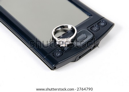 PDA with wedding ring, isolated on white background - stock photo