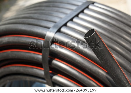 PE pipe roll for agriculture water supply - stock photo