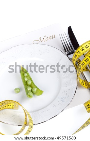 Pea and measure tape on a plate over white background
