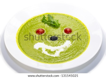 pea soup  a white dish at restaurant - stock photo