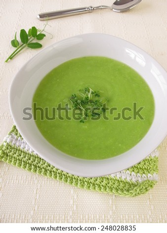 Pea soup with chia sprouts - stock photo