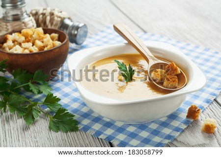 Pea soup with croutons in the bowl