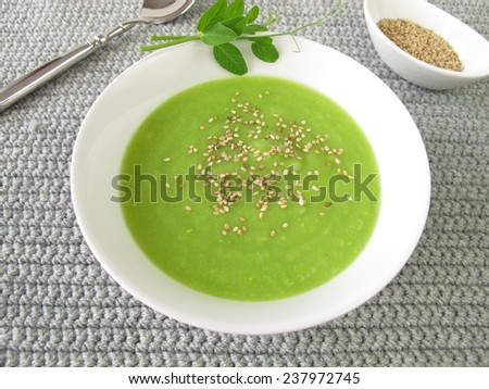 Pea soup with roasted sesame - stock photo