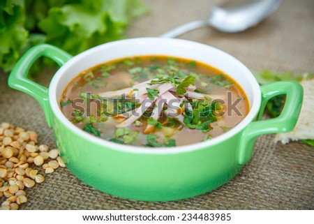 pea soup with smoked meat and greens - stock photo