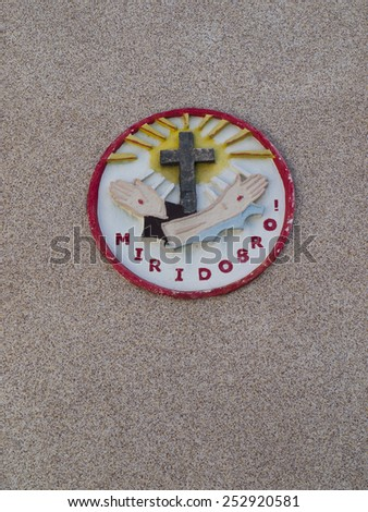 peace and good sign on the facade of the Franciscan Order - stock photo