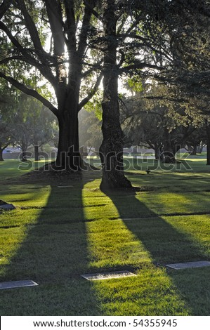 Peace and Quiet - cemetery at sunset - stock photo