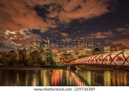 Peace Bridge over Bow River in Calgary at night, Alberta, Canada - stock photo