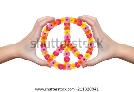 Peace flower symbol in hands  - stock photo