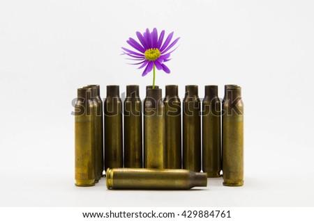 peace-full bullets, peace full bullets, bullets with flower, gun bullets shell - stock photo