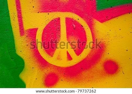 Peace graffiti sign on the wall - stock photo