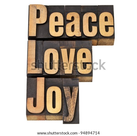 peace, love and joy - isolated words in vintage letterpress wood type - stock photo