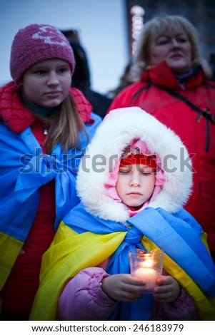 Peace march in a tribute to the victims - killed passengers of bus ruined under Volnovakha, Kyiv, Ukraine, 18 January 2015 - stock photo