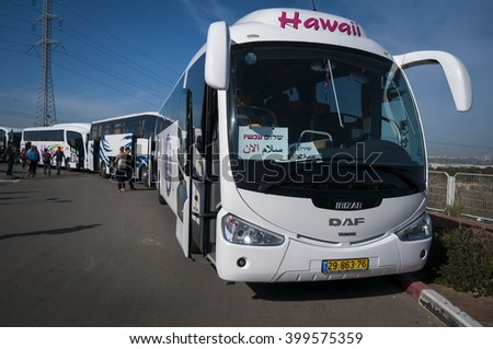 Peace Now (Shalom Achshav in Hebrew) buses lined up for a tour for the Israeli public in the West bank. Peace Now is a leftist watchdog organization. Umm el-Fahm, Israel, January 2014. - stock photo