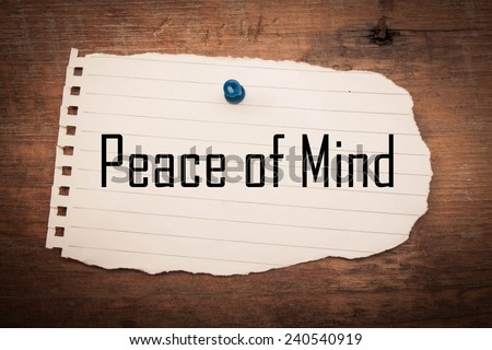 Peace of mind text on paper torn and wood  - stock photo