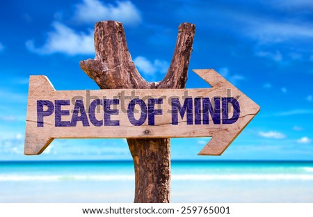 Peace of Mind wooden sign with beach background - stock photo