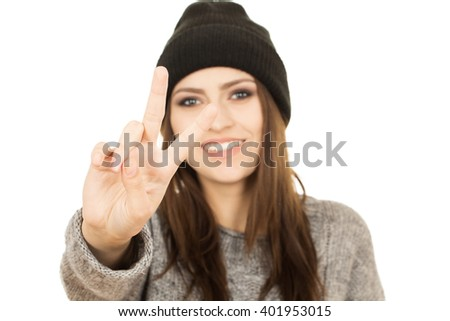 Peace out. Close up shot of smiling hipster girl showing peace gesture.