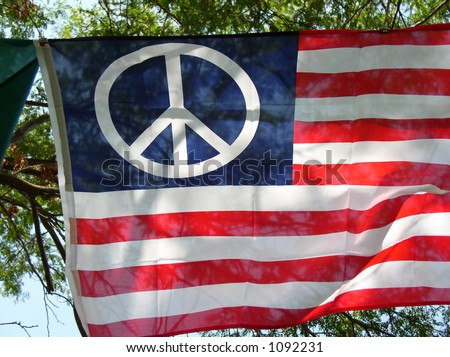 Peace Rally Labor Day,  Cleveland 2005 - American flag with peace symbol. - stock photo