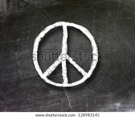 peace sign hand-drawn on a chalkboard - stock photo