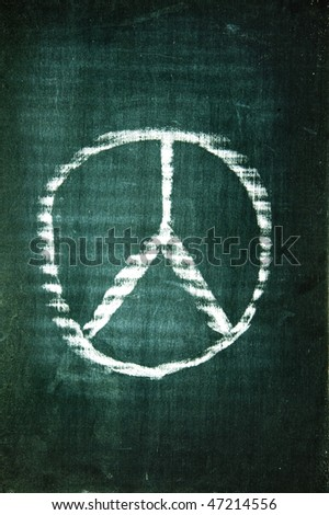 peace sign written with a chalk on a blackboard - stock photo