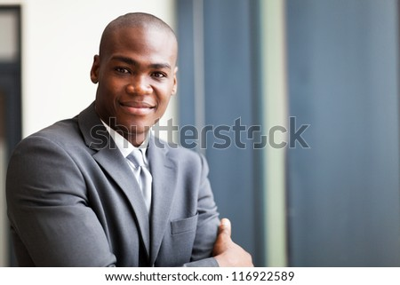 peaceful african american businessman in office