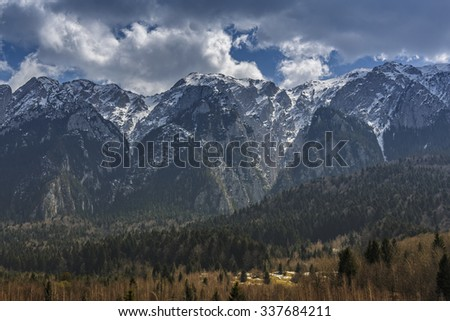 Peaceful alpine landscape with snowy mountains range in the Bucegi National Park, Romania. Travel destinations, touristic attractions. - stock photo