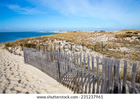 Peaceful Atlantic Ocean seashore view at Cape Henlopen in the State of Delaware a popular destination for relaxation and history. - stock photo