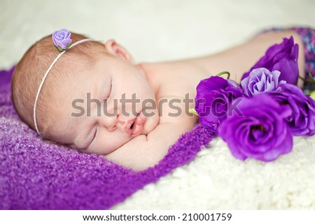 Peaceful baby lying  while sleeping in a bright room - stock photo