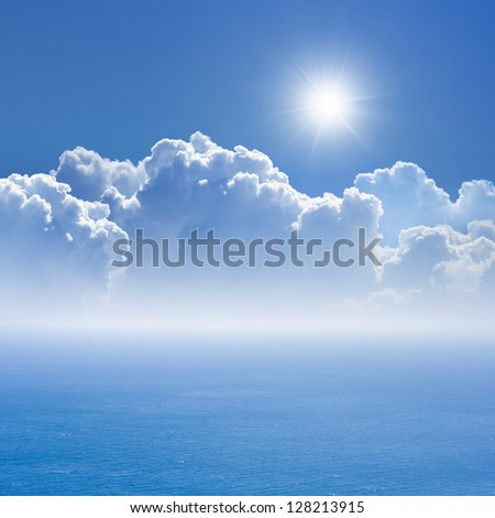 Peaceful background - blue sea and sky, white clouds, bright sun - heaven - stock photo