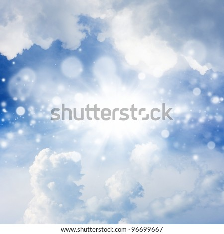 Peaceful background - bright sun, blue sky, white clouds - heaven - stock photo