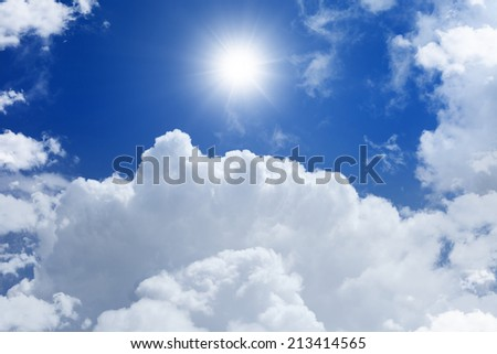 Peaceful background - bright sun in blue sky with white clouds, light from heaven - stock photo