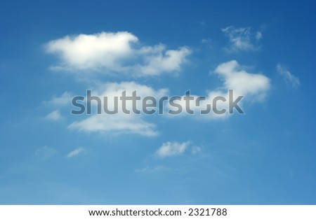 Peaceful blue sky with white clouds - stock photo