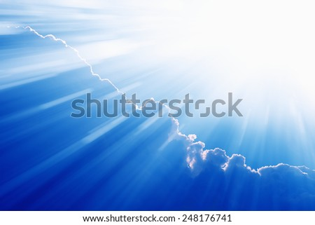 Peaceful easter background - beautiful blue sky with bright sun, light from heaven - stock photo
