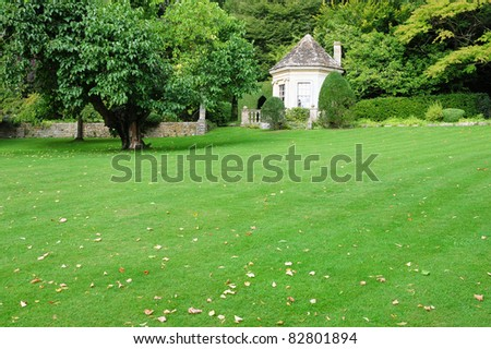 Peaceful Garden with a Freshly Mown Lawn - stock photo