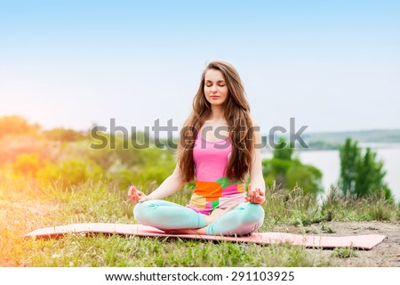 Peaceful Healthy & Fitness Young Woman Meditating on the nature with eyes closed - stock photo