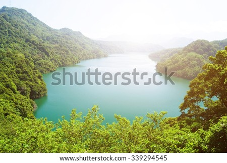peaceful lake surround by forests and mountains. Asia, Taiwan - stock photo