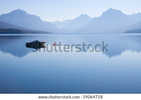 Peaceful landscape of  a power boat moored in the water - stock photo