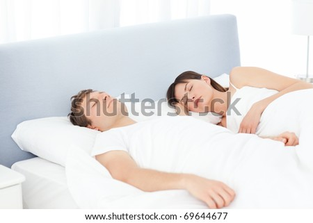 Peaceful lovers sleeping together at home - stock photo