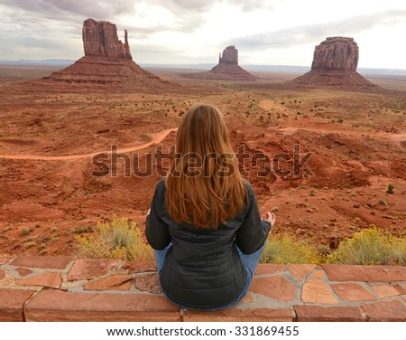 Peaceful moment in Monument Valley while meditating in front of the famous buttes - stock photo