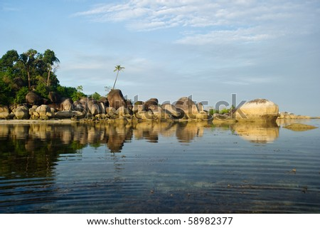 peaceful morning reflection on belitung indonesia - stock photo