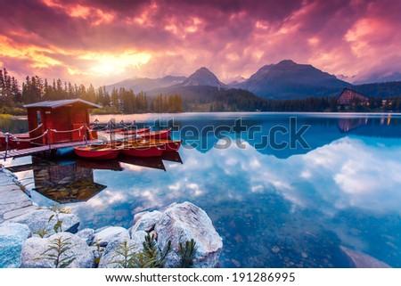 Peaceful mountain lake in National Park High Tatra. Dramatic overcast sky. Strbske pleso, Slovakia, Europe. Beauty world. - stock photo