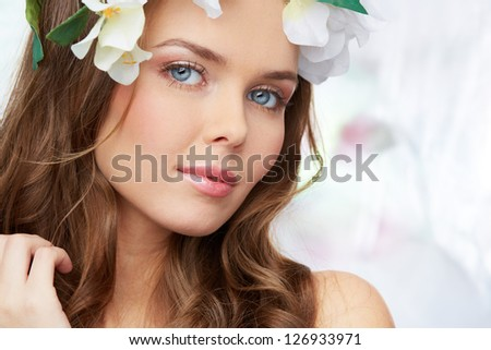 Peaceful portrait of a charming young lady waiting for spring