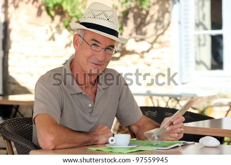 Peaceful retiree sitting at a table